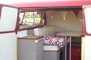 VW Campervan Curtains and cushions in Clarke and Clarke Anja Summer fabric in a splitscreen van interior with bunting adventuresinacampervan.wordpress.com