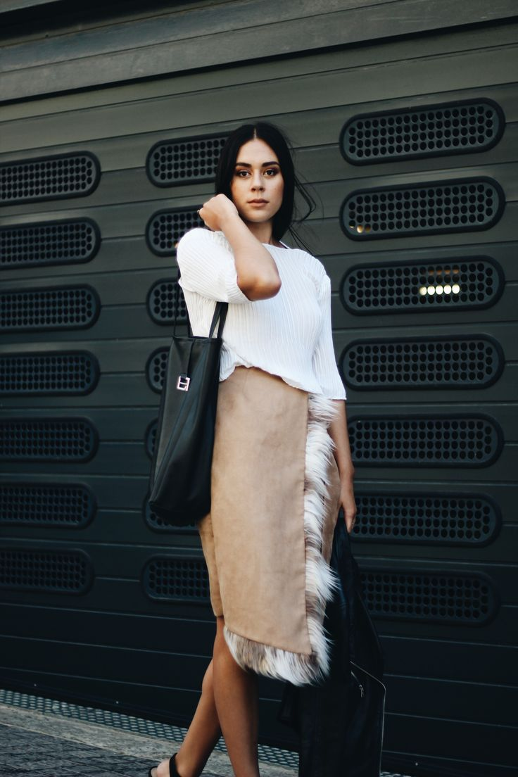 Cape Town based creative, Gemma Shepherd, photographed and styled by Rebecca Arendse for theminimaleblogger.com   Wearing A Seam Studios pleated top, faux leather tote bag and asymmetrical faux fur skirt.
