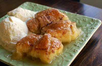 Apple Dumplings 2 sticks butter 1 tsp. vanilla 1 1/2 cups sugar 2 tubes crescent rolls 2 granny smith apples 12 ounces of Mountain Dew Cinnamon Vanilla ice cream Directions: Peel and slice your apples. Wrap each slice in a crescent dough triangle and place in sprayed (greased) pan. In a bowl, melt your butter and stir in sugar and vanilla. Pour over top of the wrapped apples....or spread on top with a spoon. Pour the Mt. Dew all around and sprinkle with Cinnamon. Place in 350 degree o...