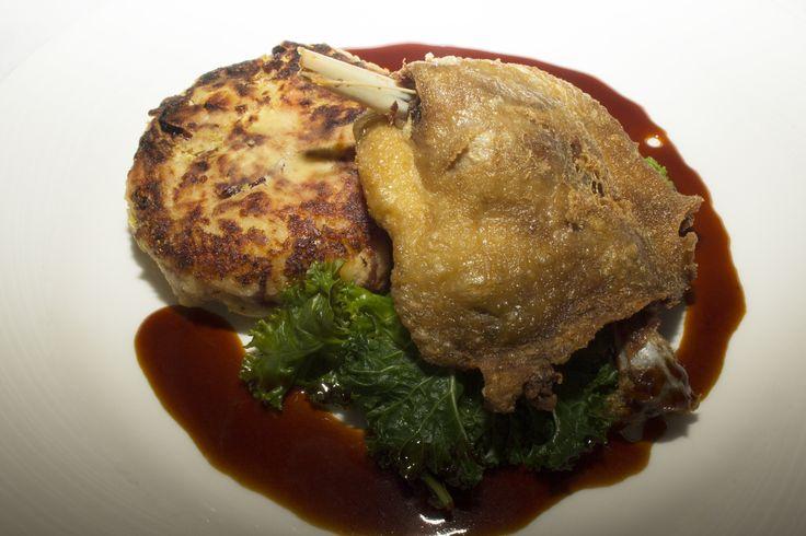 Confit Duck with Lancashire Potato cake, cumin kale and jus.