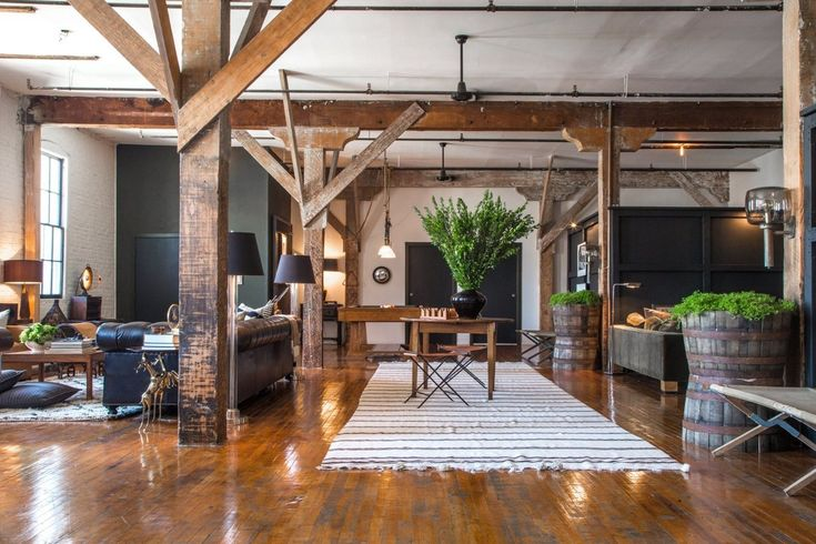 Scott & Kristan's Inspiring Arts District Loft. A little too masculine, but love the mix of wood and greenery, and the white walls and textiles to lighten it up.