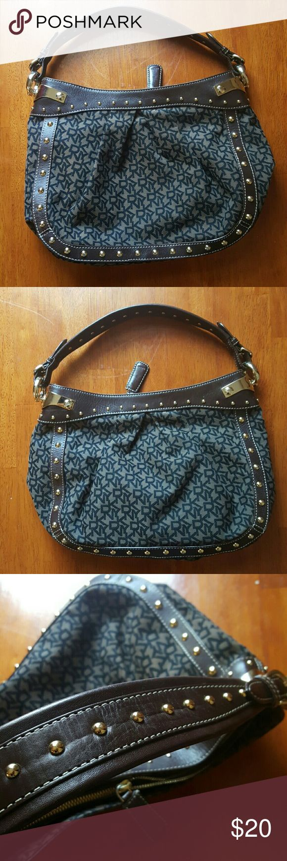Dkny handbag Brown leather with gold buckle and studs...black dkny signature on bag...in great condition Dkny Bags