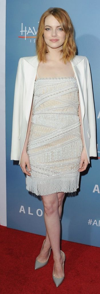 Emma Stone in a white flapper-inspired embellished minidress with a sleek white blazer