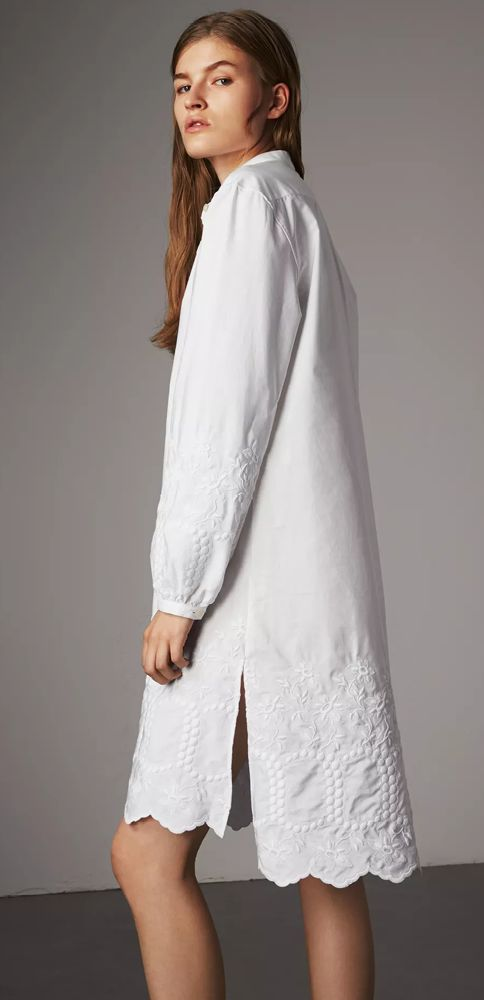 An airy shirt dress by Burberry in Italian-woven cotton poplin. The design is detailed with tactile floral embroidery and a scalloped hem, with gathered sleeves for gentle volume.