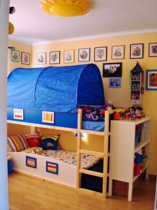 Bunk beds, this color scheme reminds me too much of Caillou but I'm still digging the curved roll out guard on the bottom bunk.
