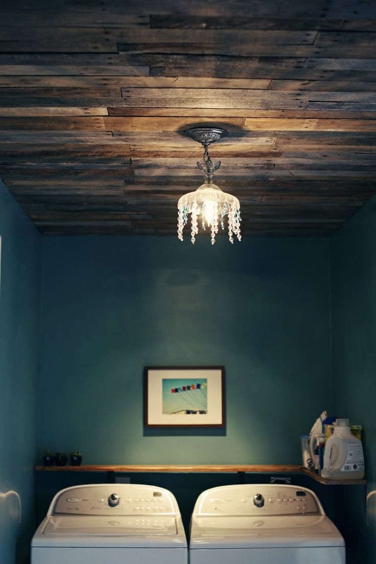 Wood Ceiling in the Laundry Room - possible the most chic laundry room ever. I love the wall color and the little chandelier.
