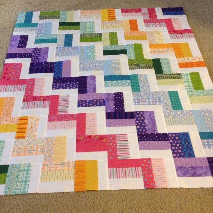 Raggedy Rainbow Rail Fence quilt. By a Raveler (http://www.ravelry.com/discuss/quilters-knitting/2098060/226-250#237)