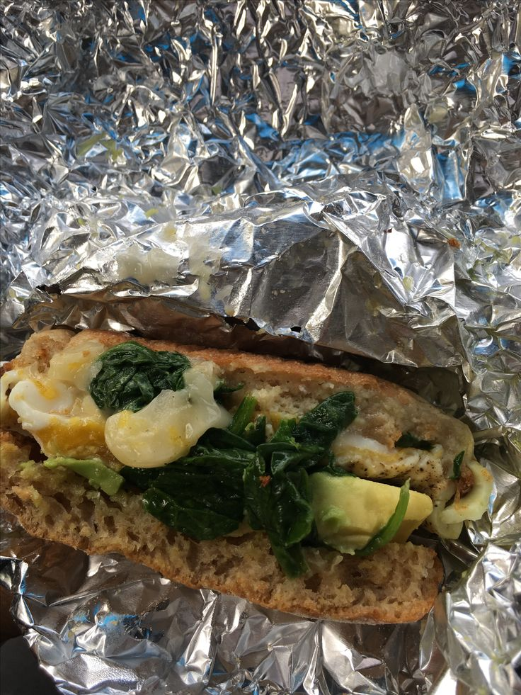 Breakfast sandwich with Munster cheese, spinach, fried egg and avocado