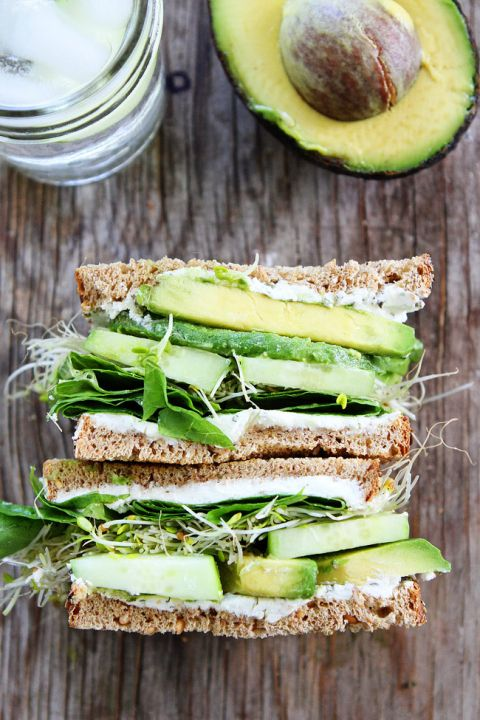 Cucumber and Avocado Sandwich Recipe on twopeasandtheirpod.com This fresh and simple vegetarian sandwich is made with cucumber, avocado, lettuce, sprouts, and herbed goat cheese. It is great for lunch or dinner.