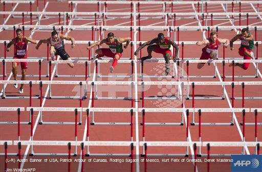 (L-R) Austin Bahner of USA, Patrick Arbour of Canada, Rodrigo Sagaon of Mexico, Kurt Felix of Grenada, Derek Masterson of USA and Roman Garibay of Mexico compete in the 110M Hurdles in the Men's Decathlon at the 2015 Pan American Games in Toronto July 24, 2015 - AFP/Jim Watson