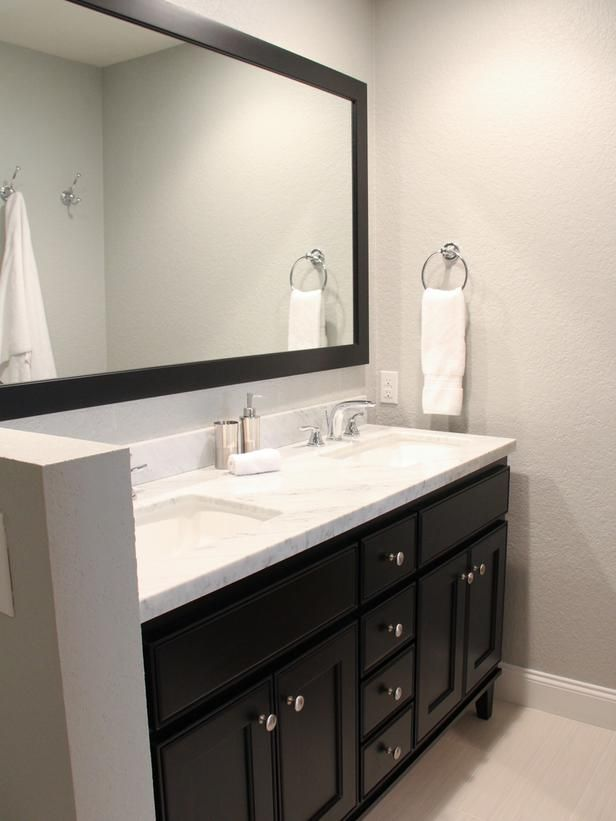 Contemporary Bathroom With Black Vanity And Mirror On