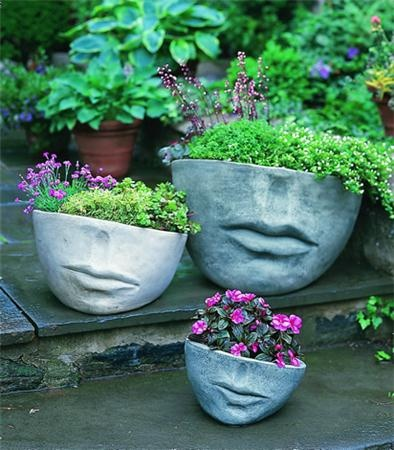 FACCIA PLANTER  Part of our line of cast stone pottery by Campania International, the Faccia Planter (Small) is sure to be a unique focal point for any outdoor setting. Made of cast stone – commonly used in construction of bridges, skyscrapers and cathedrals – the Faccia Planter (Small) is not sealed, which allows the piece to develop an antiqued look, in time aging both gracefully and naturally. This is the perfect way to complete any outdoor garden or courtyard.