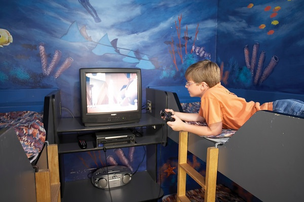 Child enjoying himself in the Themes Room at Canad Inns Garden City http://www.canadinns.com/stay/stay-main.php?entry_id=8567