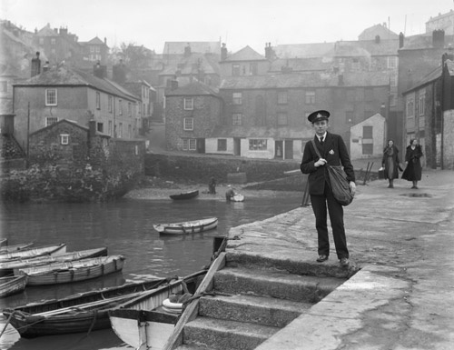 Polruan – postman standing at quayside. (POST 118/250) Find out more about our photography collections at our gallery talk on Thursday 7 June 2012: http://bit.ly/N2UJCS