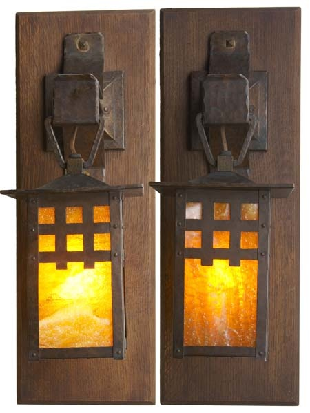 GUSTAV STICKLEY Pair of hammered copper wall sconces lined in hammered agate glass. Fine original dark patina, professionally reglued glass of the period.