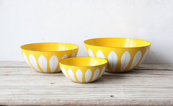 Designed by Grete Prytz Kittelsen and Made in Norway for Cathrineholm, this colorful sunny enamel cookware is a favorite with collectors. The