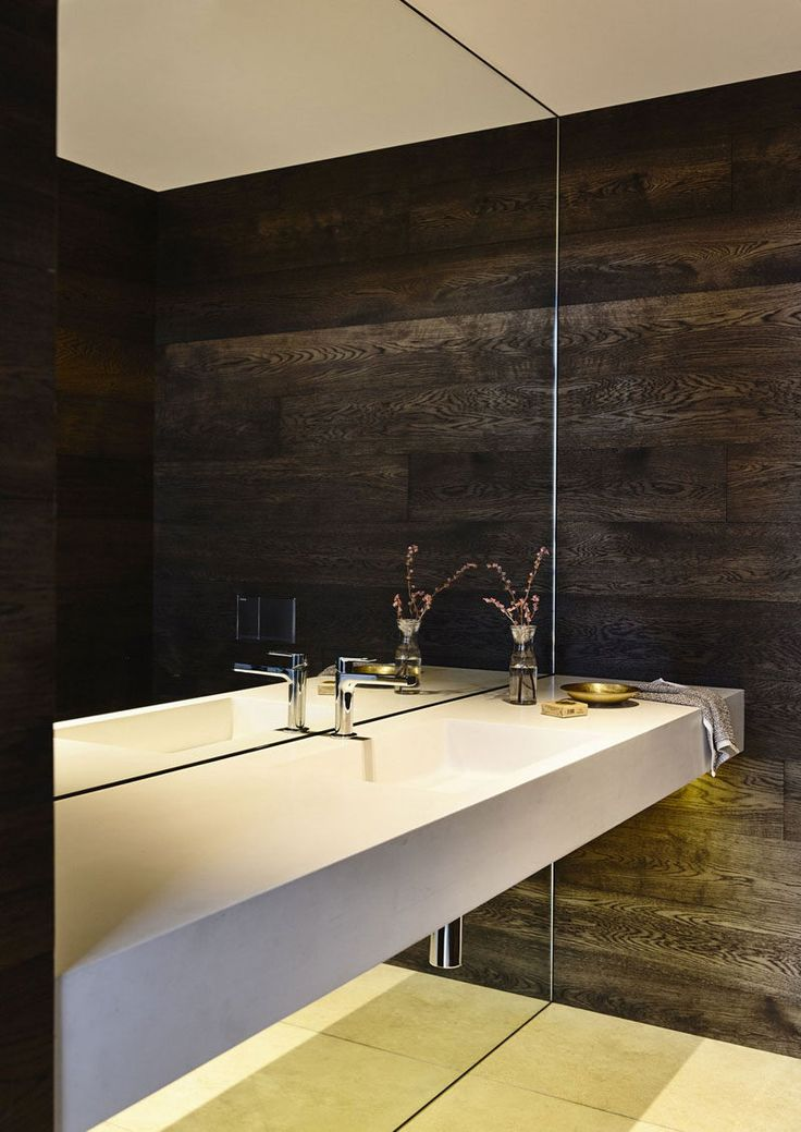 Bathroom Mirror Ideas - Fill The Wall // The giant mirror in this bathroom starts at the floor and goes all the way up to the ceiling interrupted only for a moment by the vanity.