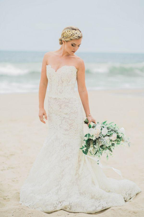 Beachgoing bride wearing a gold-threaded lace gown and a gilded Grecian headpiece | Photo by Elizabeth Burgi