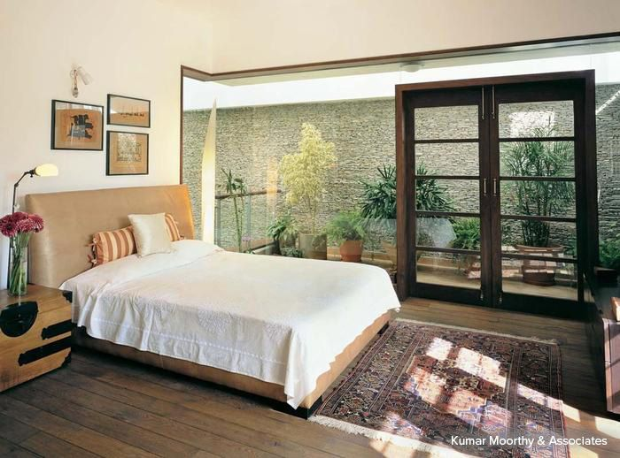 The spectacular use of glass to separate the living area from a portico housing potted plants gives an impression of a spa retreat  #bedroom #homedecor #pastel #contemporary Design Courtesy - Kumar Moorthy & Associates, Delhi