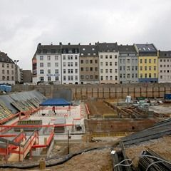 Cranes loom over the construction site where the new Historical Archive is to be built in Cologne, Germany,