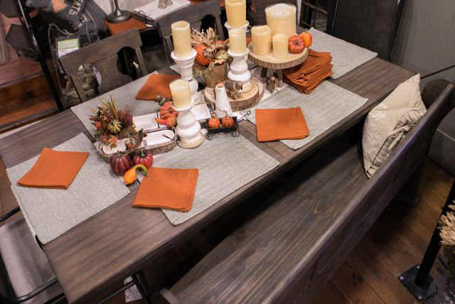 A beautiful contrast between colors and textures of place mats and napkins makes for a beautiful table! This table is from CF Home at Gardner Village.