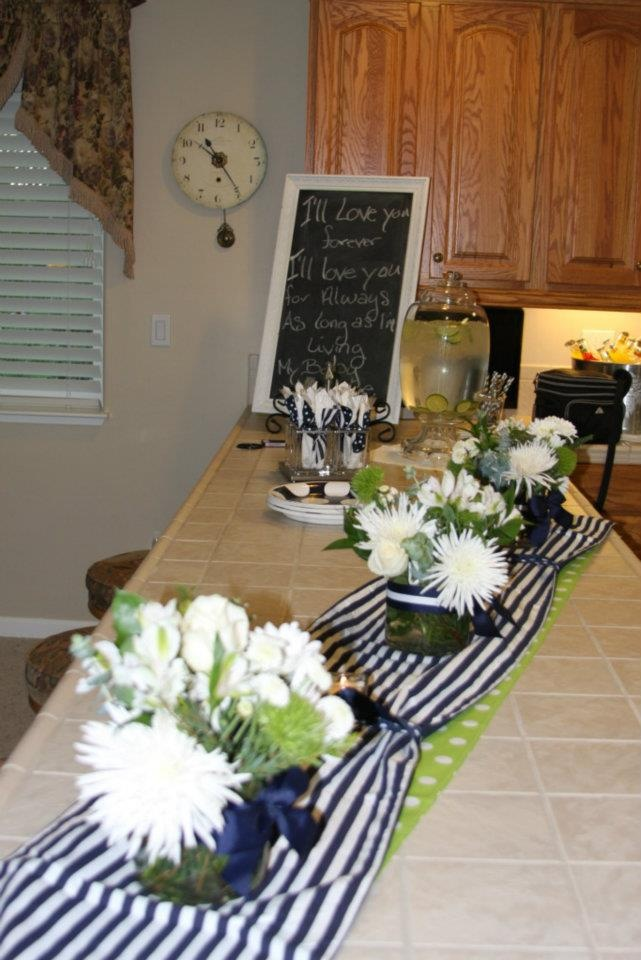 """Theme Navy Blue & White With A Hint Of Lime Green...  Vase's wrapped with ribbon were Created By: """"Showered In Love"""" Flower's purchased from Costco"""