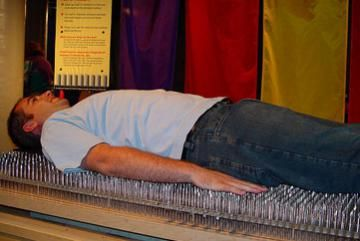 Bodily Feats Image Gallery The large nails used to make a bed of nails often aren't very sharp. Sometimes, they're not sharp enough to puncture a balloon on contact. See more bodily feats pictures.