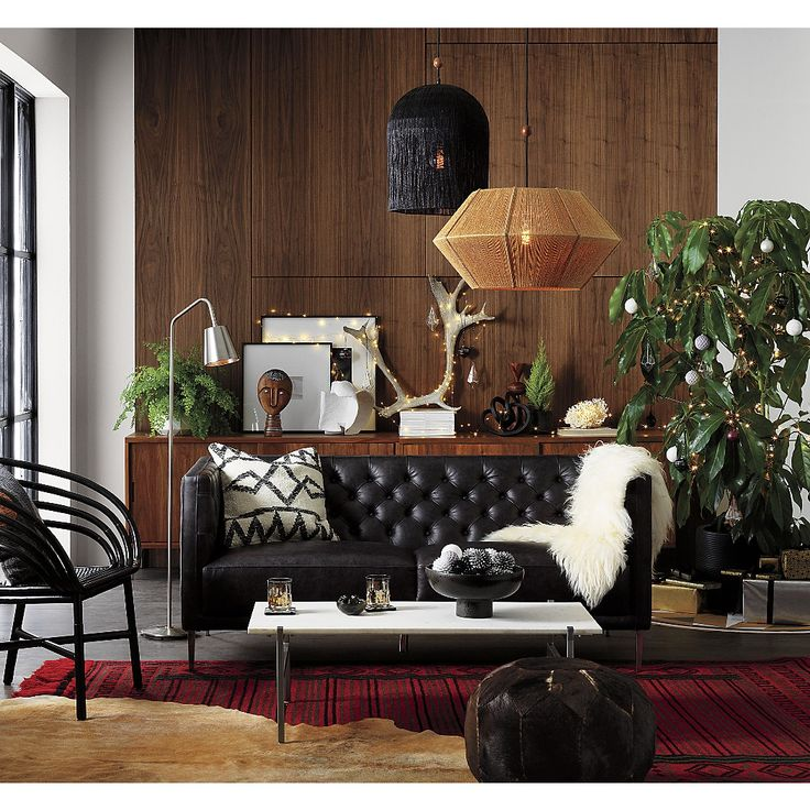 """Shop Market Black Rattan Desk Chair. """"Midcentury optimism blended with the best of coastal lifestyle,"""" is one of our favorite design ideas behind the CB2 X Fred Segal collab."""