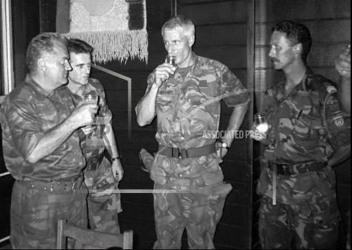 Leonard van Buren, 343628. This picture was taken during a meeting between the Serbian General Mladic and the commander of Dutchbat III Karremans. They met just before the Srebrenica massacre started which in itself was a part of the Bosnian Civil War. Dutchbat was in charge of defending Bosnians from Mladic but was ill-equipped and outnumbered. The Serbs went into Sebrenica and massacred thousands of civilians, and it is considered to be the worst genocide in Europe since World War II…