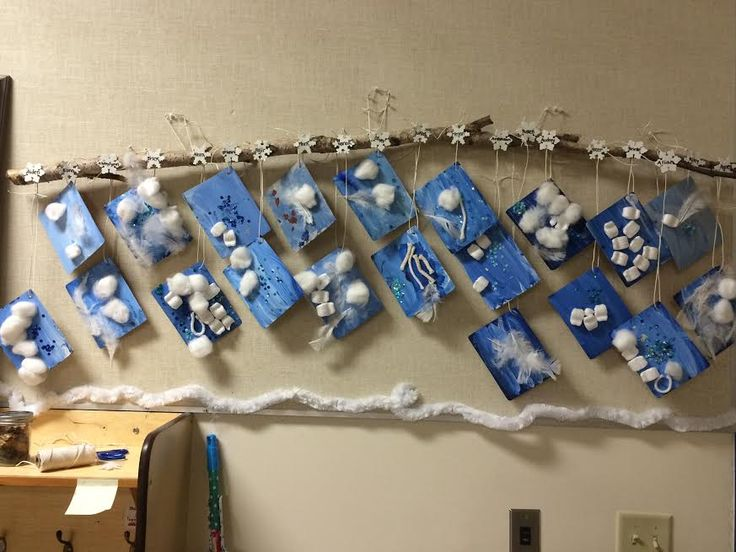 Snowflakes: Wood laminate samples covered with paint (blue and white mixed, proper brush stroke technique taught), white craft items (cotton, string, packing peanuts etc), blue sequins, stick