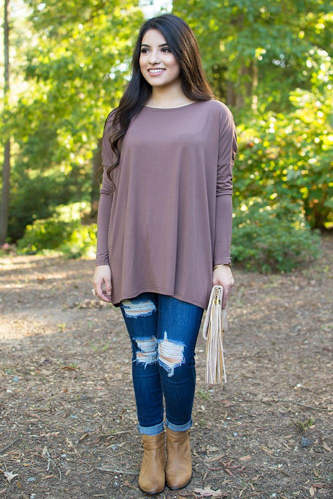 PIKOut your favorite PIKO! Everybody's favorite must-have top is back and in SO many colors! Add this brown mocha colored boatneck top to your wardrobe for undeniable beauty and all day comfort! Dress