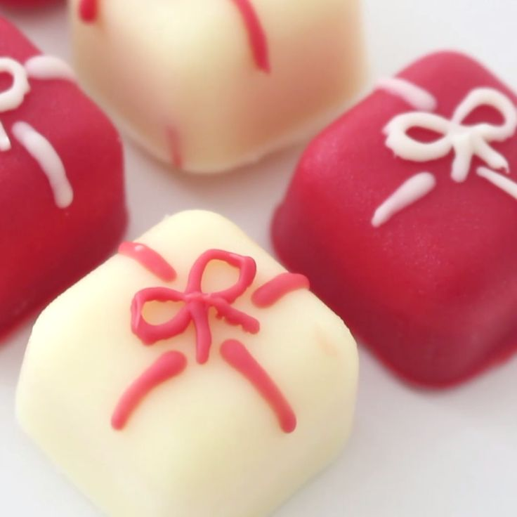 These cute white chocolate truffles look like little presents and are filled with a candy cane white chocolate ganache.