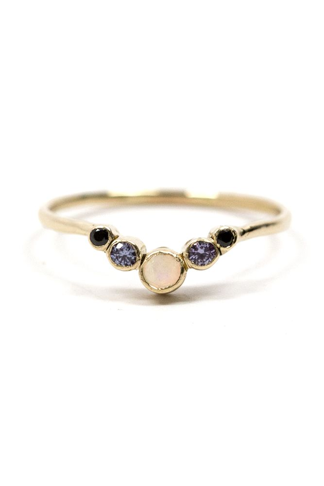 """Esther, named as the queen who was crowned for her beauty and known for her courage. This ring is a regal beauty. Dimensions: Stones measure between approximately 1/9"""" and 1/20"""" across. Details: Solid"""