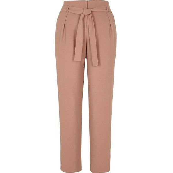 River Island Cream tie waist tapered pants ($70) ❤ liked on Polyvore featuring pants, cream, tapered pants, women, loose fit pants, tall pants, tapered leg pants, tapered fit pants and beige pants