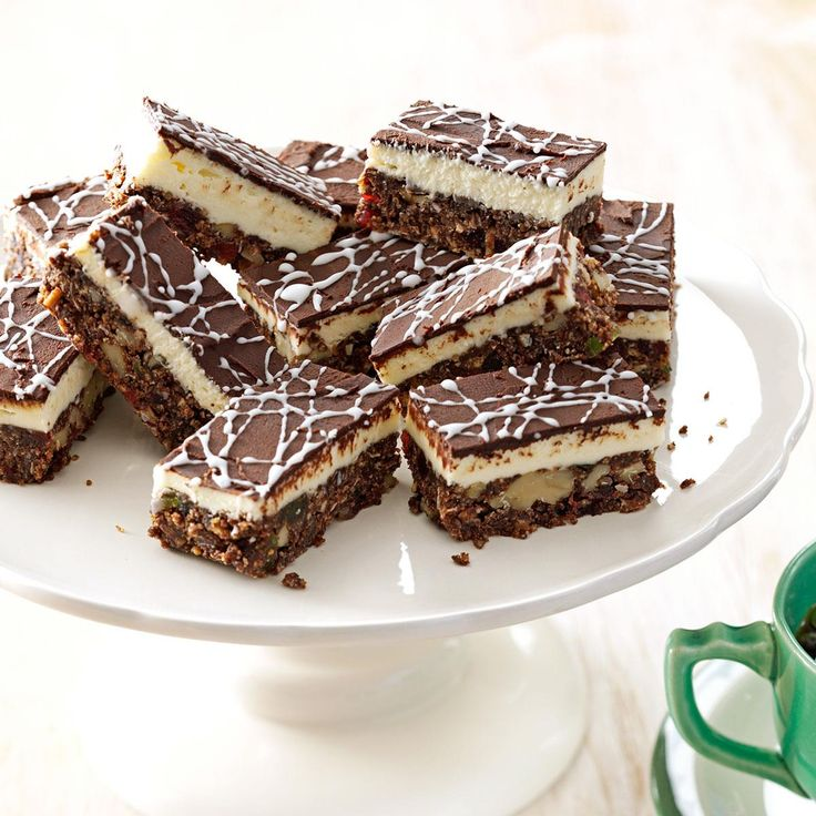 Decadent Nanaimo Bars Recipe -There are few things as Canadian or as addictive as no-bake Nanaimo bars (named for the town in British Columbia that made them famous). For festive flair, add candied fruit and ginger.—Agnes Ward, Stratford, Ontario