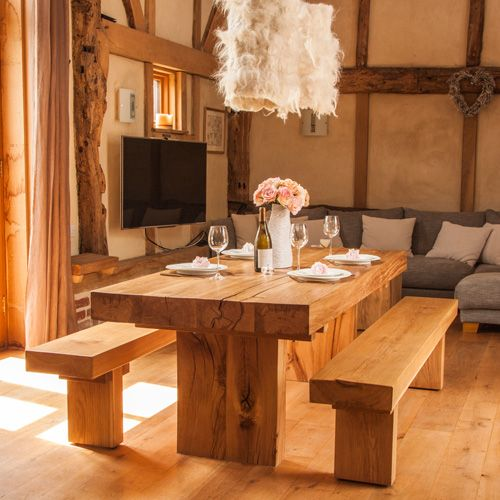 a simple and bold statement chunky oak dining table in modern rustic style perfectly suited
