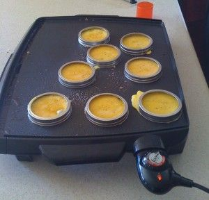 Use canning jar lids to make eggs for biscuit sandwiches on griddle or fry pan.