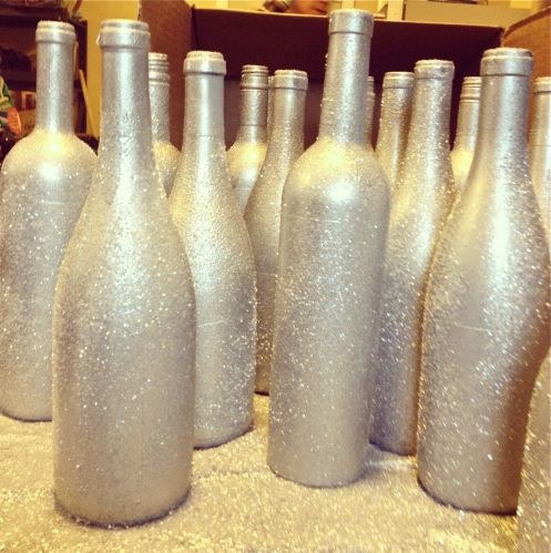 Glitter Bottles- Used this idea as centerpieces for our holiday party. They looked gorgeous!