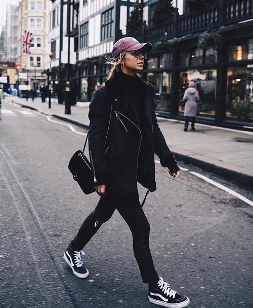Black jacket, black pants, van high tops, baseball cap