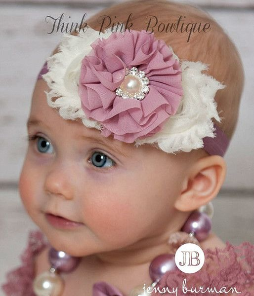 "This beautiful headband features three shabby organza flowers on an elastic headband. It is topped with beautiful vintage inspired center jewel. The flowers are felt backed for comfort. Simple and yet elegant, sure to be a real head turner!! Pair it with one of our adorable lace petti rompers for a complete look! Size ChartNewborn: 13""0-3 Months: 14""3-6 Months: 15""6 Months - 3 Years: 16""4 Years &amp"