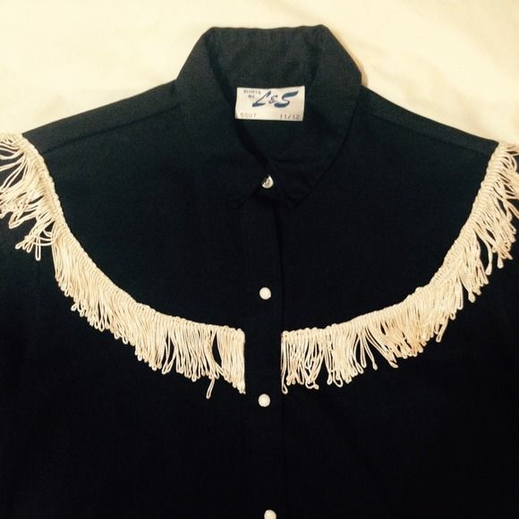 Cowgirl shirt with fringe Black cowgirl shirt with white fringe. Some of the fringe is a little pulled, but otherwise in good condition. Polyester, snap closures. Size md/lg.  Tops