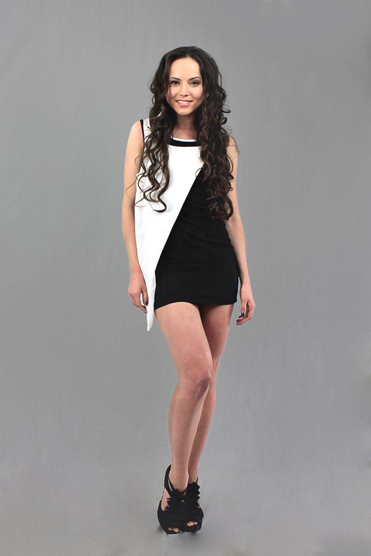 Ohh la la in black and white! mishpish.com #sleevelessdress #littleblackdress #whiteandblack #buckle #strappydress #sexydress