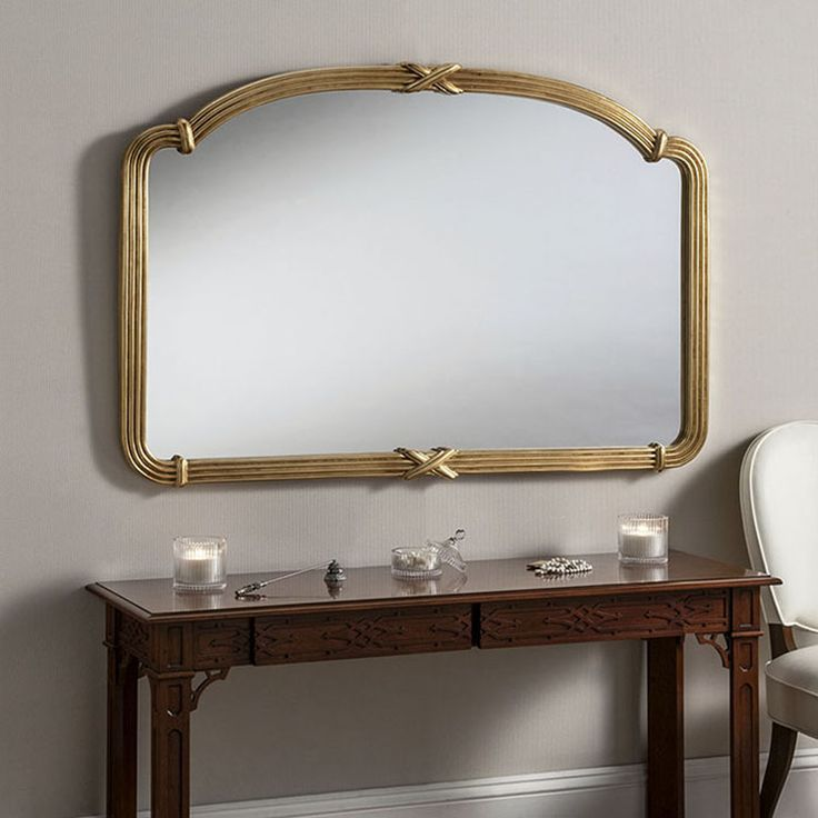 Large ornate gold mirror with criss cross