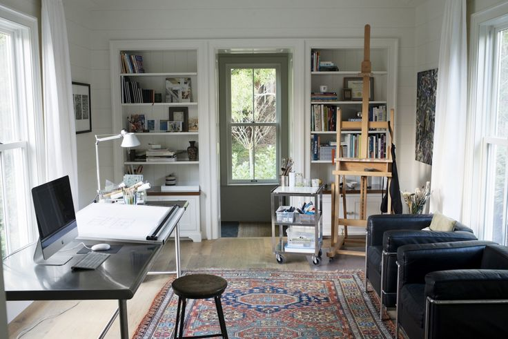 About a year after the house was complete, Barbara designed a backyard studio for her husband, architect and painter Guy Chambers. The stainless steel desk is a custom design; opposite is a pair of LC2 chairs by Le Corbusier.