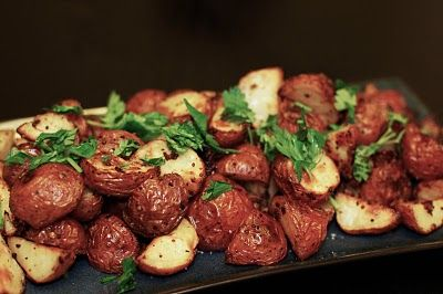 Ina Garten's Mustard Roasted Potatoes - Sounds weird, totally worth making - amazing what a little stone ground mustard can do.