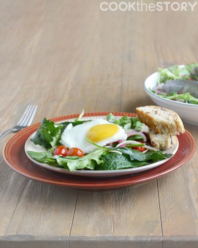 A warm salad topped with a fried egg for brunch by @cookthestory for #brunchweek