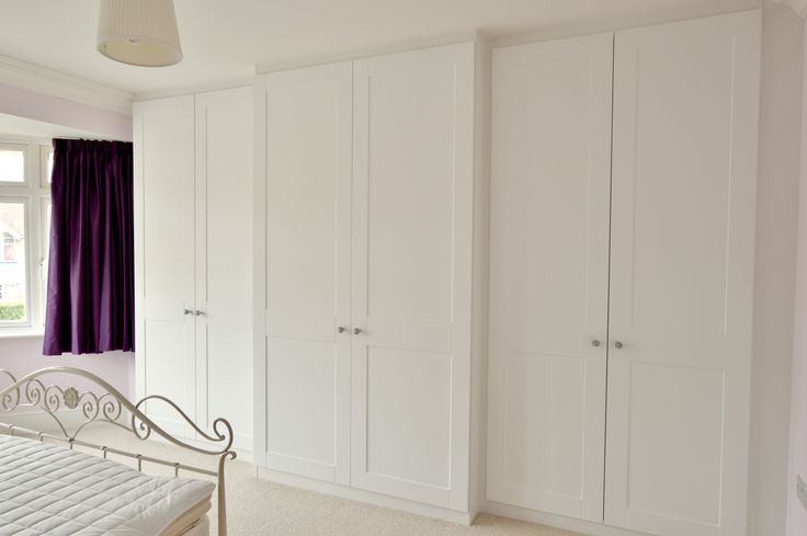 Traditional style shaker door wardrobe with all the modern fittings.  Interior lights, pull down hanging rails, full extension soft close drawers and finishing touches including Swarovski crystal knobs from Italy.