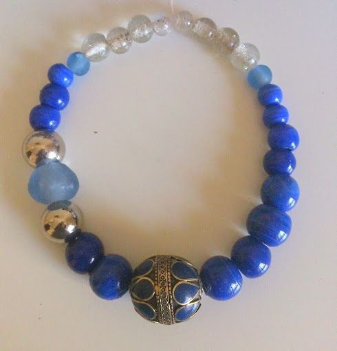 Glass  and crobo beads, turkoman focal bead and moroccan silver dome beads https://www.etsy.com/shop/FanmMon