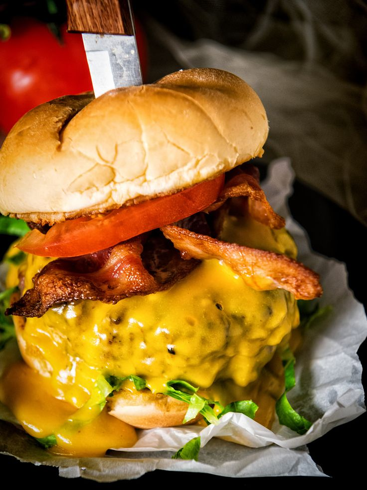 The Rarebit Cheeseburger, an all Angus burger slathered in a classic 3-cheese sauce, bacon, and lettuce. It's a napkin required kind of recipe.