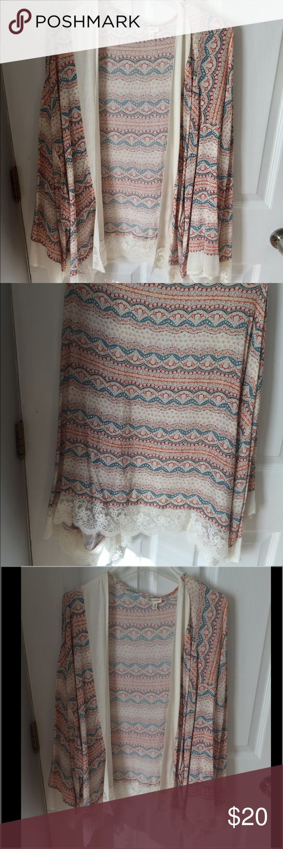 Chiffon cardigan Multicolor chiffon cardigan.  adds color to you outfit. Very flowy and flirty. Tops